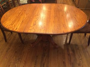Dining room table with expandable leaf for Sale in Potomac Falls, VA