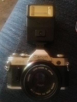 Canon ae-1 camera with flash adapter and lens for Sale in Las Vegas, NV