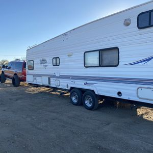 2 28ft Toy hauler Full Bath Modern Fully Fiction A Huge Garage Dirt Bike 2 Big Quads And 3 Small for Sale in Las Vegas, NV