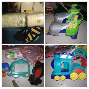 Pampers size 4 and baby toys for Sale in Stockton, CA