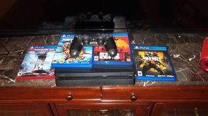 Pristine Condition PS4! 1TB Model... Comes with four games and two Dualshock controllers! for Sale in Phoenix, AZ