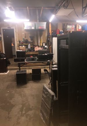 Garage with amplifiers and subwoofer and speakers with Erk rack (with wheels and unused door) for Sale in Aurora, CO