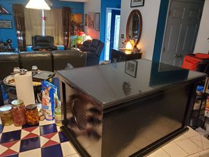 Glass top coffee table with enclosed compartment for Sale in Greensboro, NC