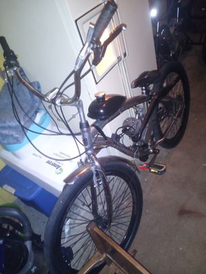 29' chrome genius mountain bike with a 80cc motor for Sale in Peoria, IL