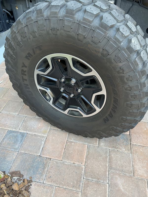 "Jeep Rubicon rims and 37"" mid tires. Excellent condition."