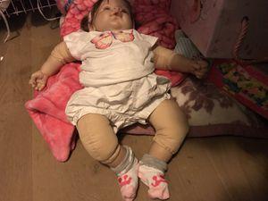 Newborn baby doll with clothes and diapers and baby bottles for Sale in Salt Lake City, UT