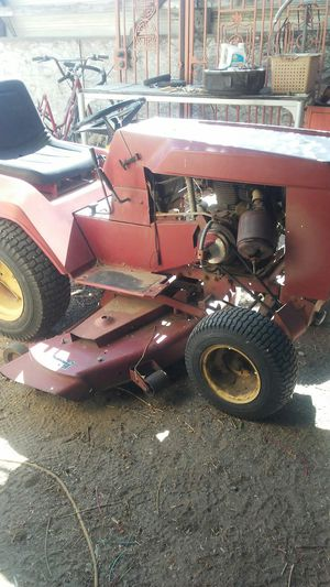 Check( price) wheel horse garden tractor~ still runs for Sale in Fontana, CA