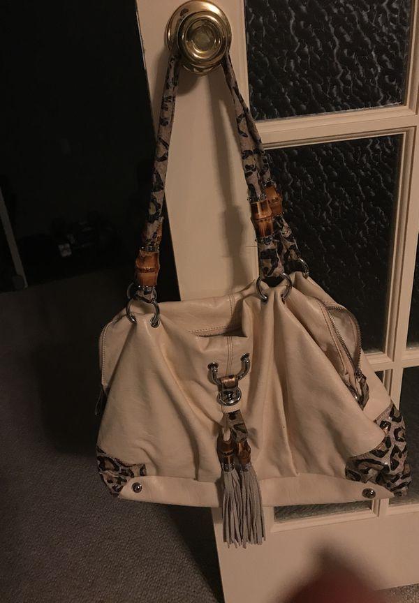 Hobo bag 1 month old big & roomy pockets inside & out .