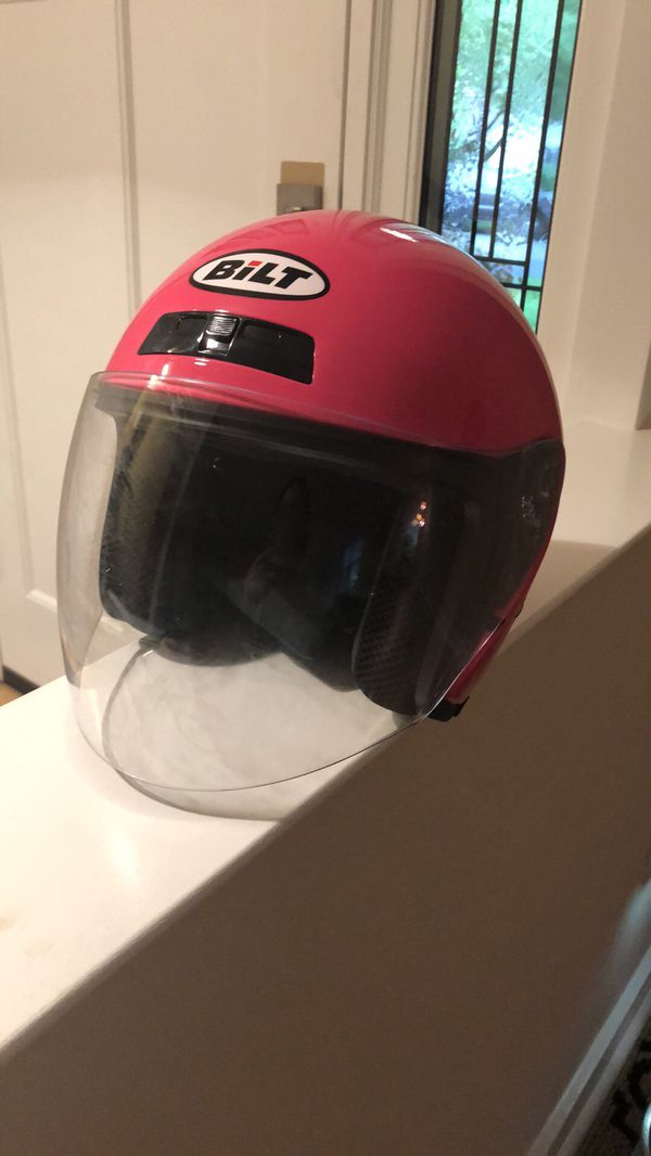 Extra small bright pink motorcycle helmet