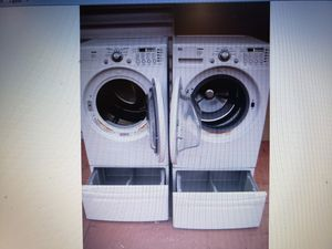 LG WASHER AND ELECTRIC DRYER SUPERCAPACITY WITH PEDESTALS for Sale in Hialeah, FL