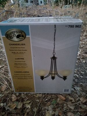 Chandelier New In The Box/Forged Bronze Finish Ivory Glass Dhades for Sale in Auburn, CA