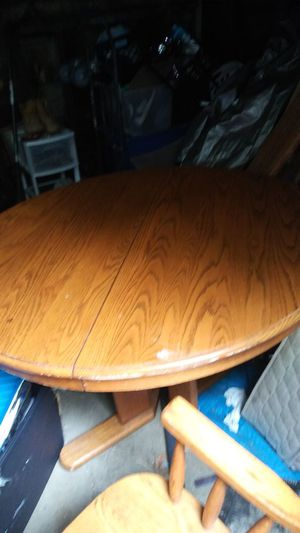 Solid oak table and chairs for Sale in Columbus, OH