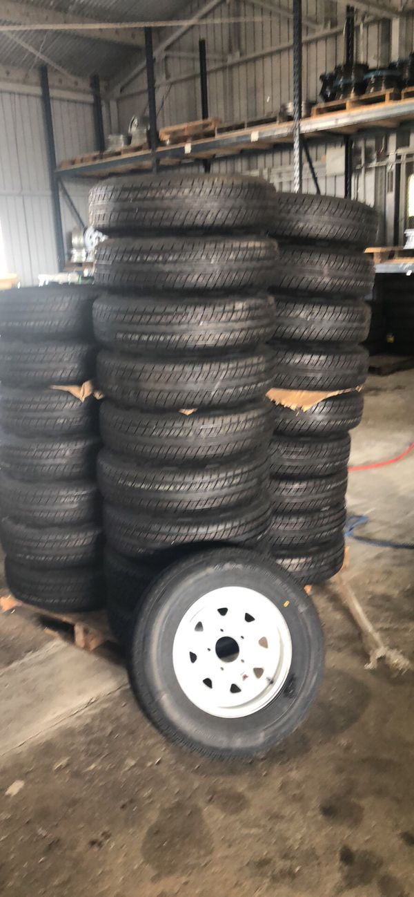"""15"""" 5 lug trailer tires on sale. New radial 205/75/15 on 5 lug silver mod. We install for free"""