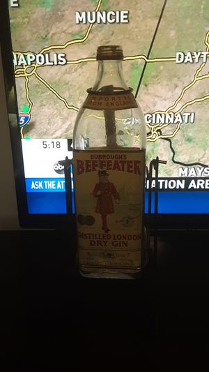 Antique beefeater tilt gun bottle and bracket for Sale in Columbus, OH