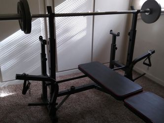 Adjustable Olympic Weight Bench Press And Olympic Weights Set And 7' Barbell for Sale in Rancho Cordova,  CA