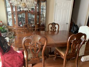 Dinning room table. 8 Chairs and an expander for extra place settings. for Sale in Springfield, VA