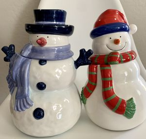 Set of 2 like new ceramic / glass snowman & snow woman cookie jars for Sale in Phoenix, AZ