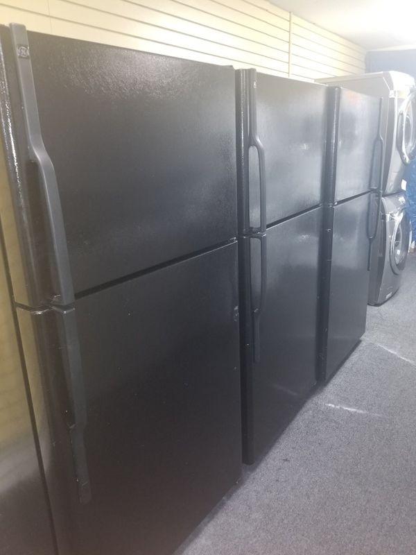 "Black 33""wide top freezer refrigerators in excellent condition"