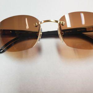 Cartier Gold Black Buffalo Horn Frameless Sunwear for Sale in Miami, FL