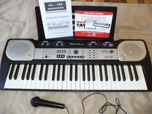 54 note keyboard (spectrum) includes mp3 input and sing-a-long mic for Sale in Las Vegas, NV