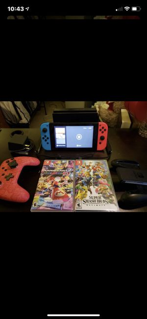 Pretty much brand new Nintendo switch with super smash brothers with one controller and original controller for Sale in Pomona, CA