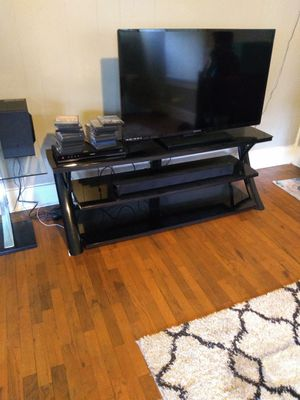 Sectional an coffee table an the two end tables match. 50 inch TV an blue player an TV stand four hundred dollars for all of it. for Sale in Iola, KS