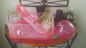 Hamster cage and ball and everyrhing goes with it will include food as well make offers for Sale in Hemet, CA