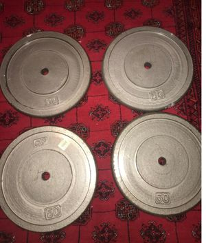 200 pounds (four stand iron coated 50lbs weight plates) for Sale in Alexandria, VA