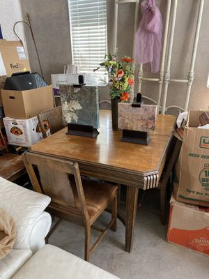antique dining room table + 4 cow skin chairs for Sale in Aurora, CO