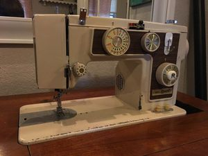 Dial n Sew 1960's heavy duty all metal sewing machine in cabinet for Sale in Austin, TX