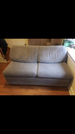 Two seater comfortable couch with an additional pull out bed for Sale in Cherry Hill,  NJ