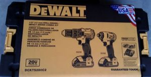 DeWalt combo set includes hammer drill impact gun two batteries charger and plastic rollaway casing as seen in picture brand new for Sale in Stockton, CA