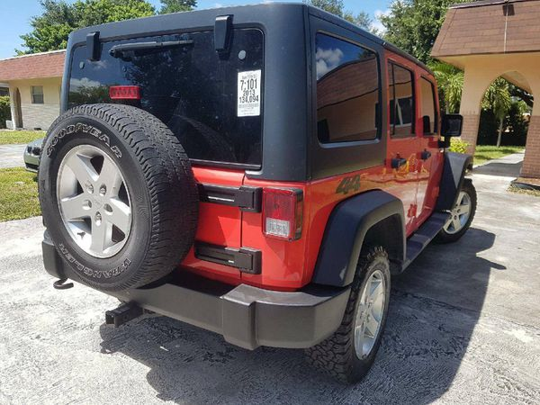 Awesome condition 2014 Jeep Wrangler Unlimited 4WD 4dr Sport SUV Drives like new clean title good miles