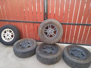 """5 matching 16"""" stock wheels with 4 tires over 50% thread for Sale in Hemet, CA"""