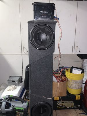 Two 12 inch subwoofers with custom amplifier for Chevy Silverado for Sale in Miami, FL