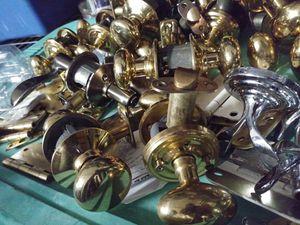 Unknown brand brass doors nobs, sun round sum ovel handles for Sale in Hillsboro Beach, FL