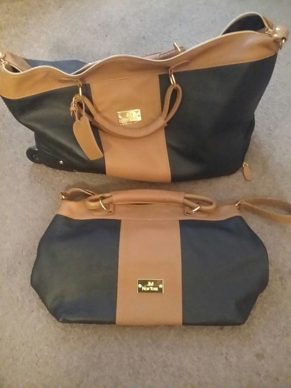 Hand and rolling bags, purse, and or luggage.