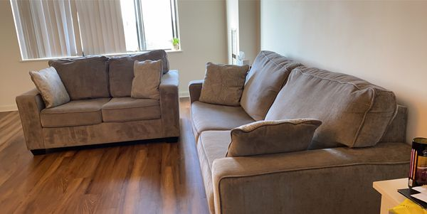 Sofa and loveseat and rug