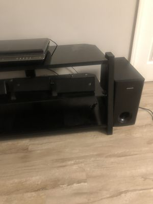 Tv stand with blue ray sound DVD player for $120 for Sale in Silver Spring, MD