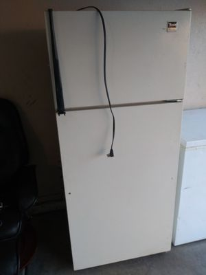 The refrigerator works perfectly only the boxes of the vegetable ready for a garage are missing. for Sale in Phoenix, AZ