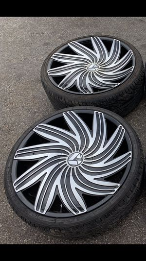"22"" black Rims and Tires with 80% tread. 5 lug Universal Bolt pattern will fit Chevy Camaro , BMW , Ford , Dodge Charger / Challenger / Magnum , Chry for Sale in Dallas, TX"