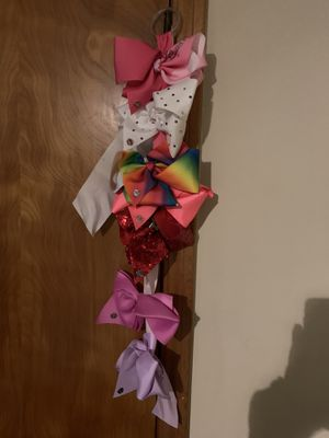 Jojo bow holder and bows for Sale in West Chicago, IL
