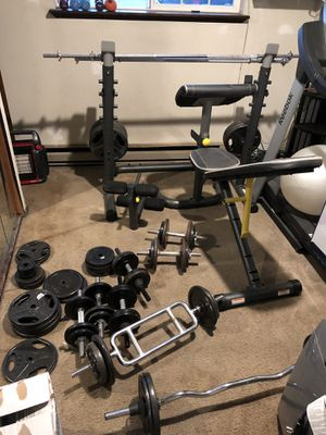 Golds gym weight bench with weights for Sale in Port Orchard, WA