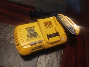 DeWalt fast charger and a batterie all new firm price for Sale in Modesto, CA