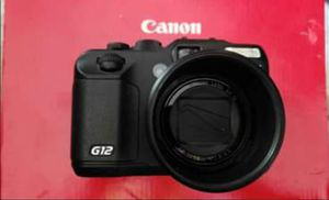 Canon powershot g12 digital camera with conversion lens for Sale in Sugar Hill, GA
