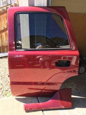 Driver side rear door. '04 GMC Yukon Denali for Sale in Morrison, CO