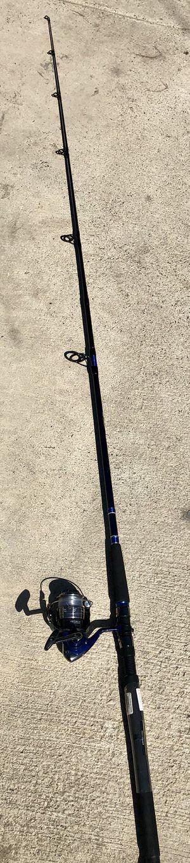 Surf ocean fishing pole daiwa d-wave 4000-3bi reel 2 piece rod for Sale in San Bernardino, CA