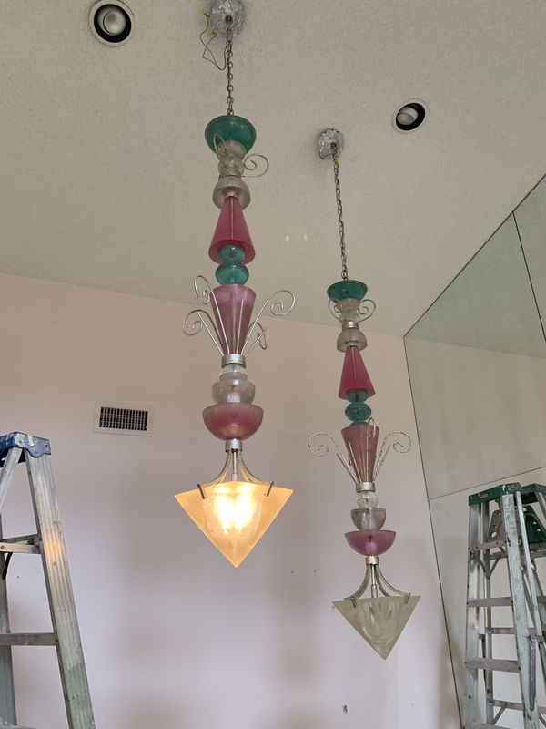 Different colored glass chandeliers. 5 feet long and about 65 lbs.