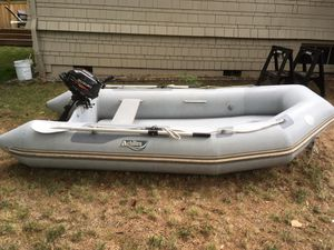 Achilles 10.5 ft inflatable with 2.5 HP Suzuki outboard for Sale in Seattle, WA