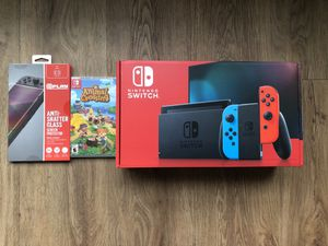 NEW Nintendo Switch Console V2 with Animal Crossing and Screen Protector In Hand for Sale in Laurel, MD